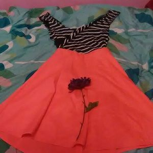 A dress with a Black and white top and orange bott